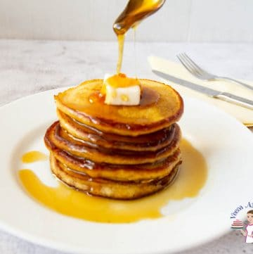 Pouring honey on the pancakes