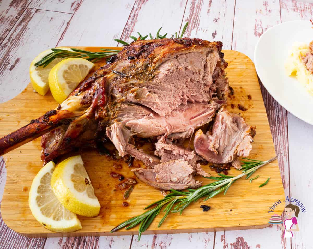 Sliced lamb on a wooden board