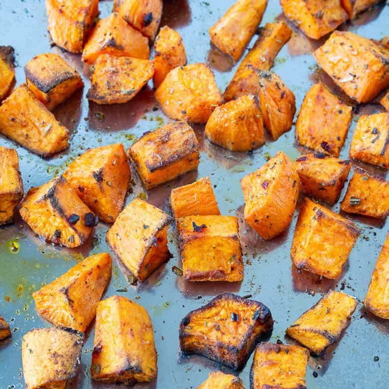 Cubes of baked sweet potato on a baking tray