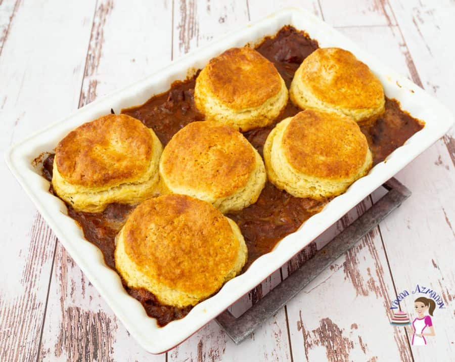 A casserole with lamb topped with biscuits