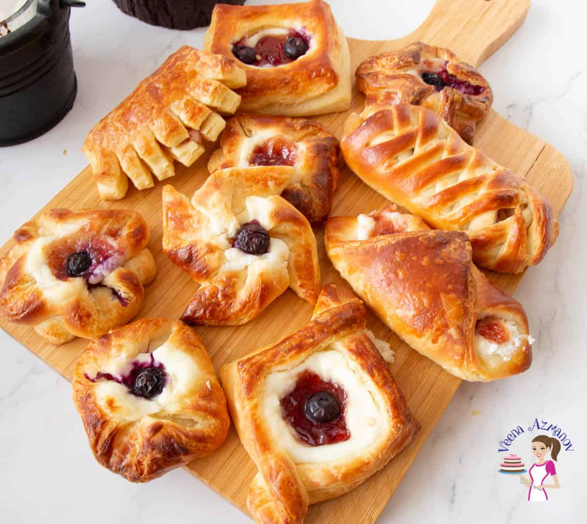 Breakfast pastries on a wooden board.