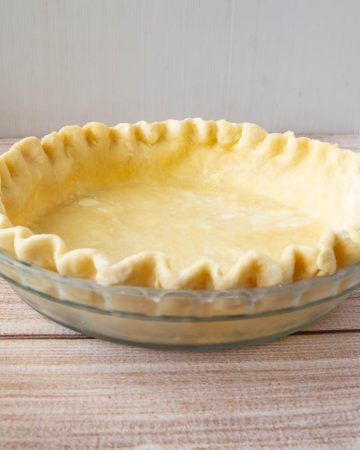 A crimped pie crust ready to be baked