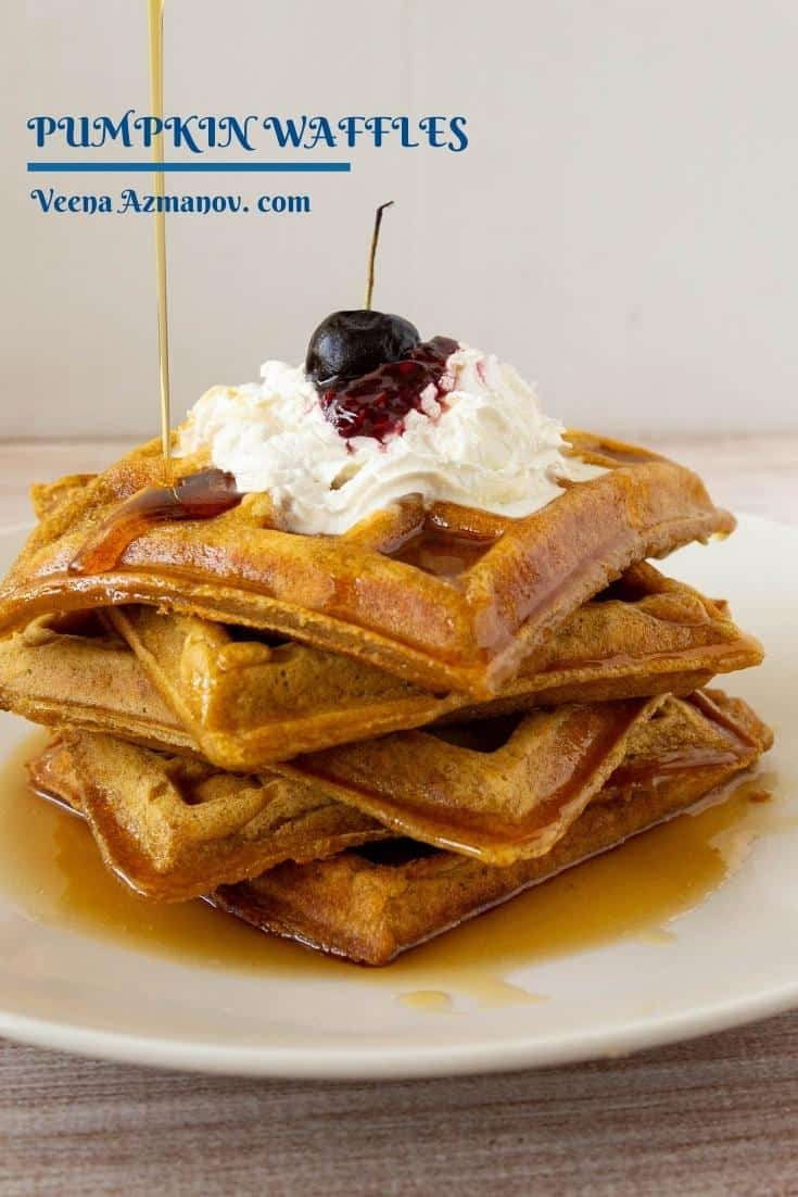 These pumpkin waffles are light and fluffy made with pumpkin puree, pumpkin spice, and brown sugar. A simple and easy recipe that gets done in less than 45 minutes #waffles #pumpkin #breakfast #pumpkinwaffles #fallrecipes #howtowaffles #pumpkinrecipes   via @Veenaazmanov