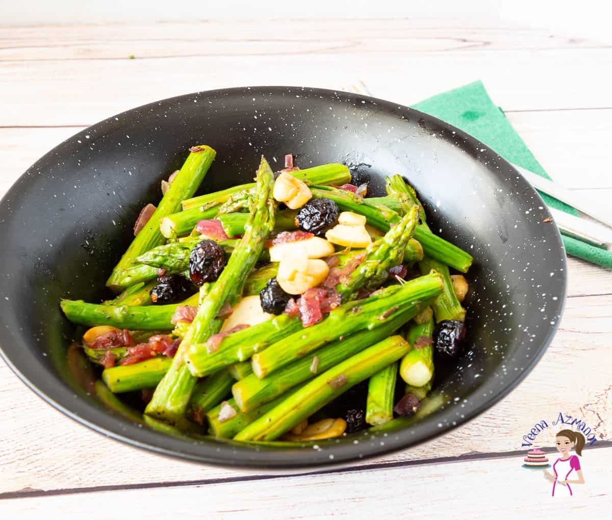 A bowl with side dish made with asparagus