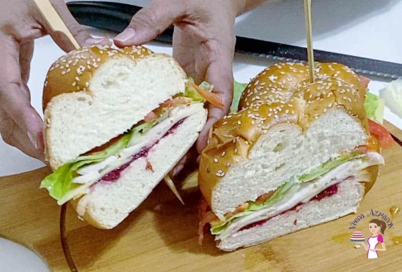 A sliced challah sandwich with turkey