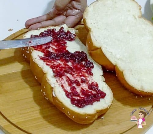Spread the cranberry sauce over the sandwich