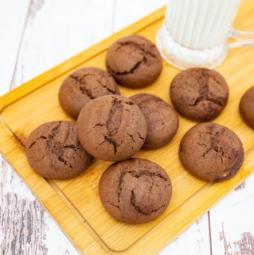 Chocolate cardamom coffee cookies on a wooden board