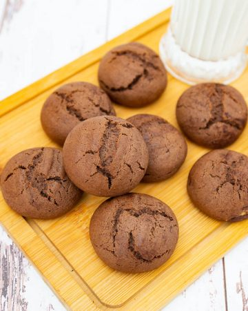 Chocolate cardamom coffee cookies on a wooden board