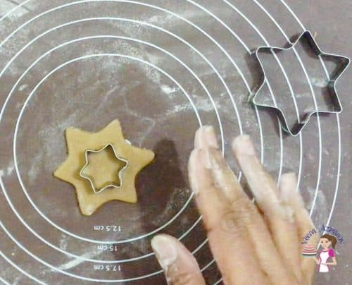 Cut the cookie shapes with a star cookie cutter