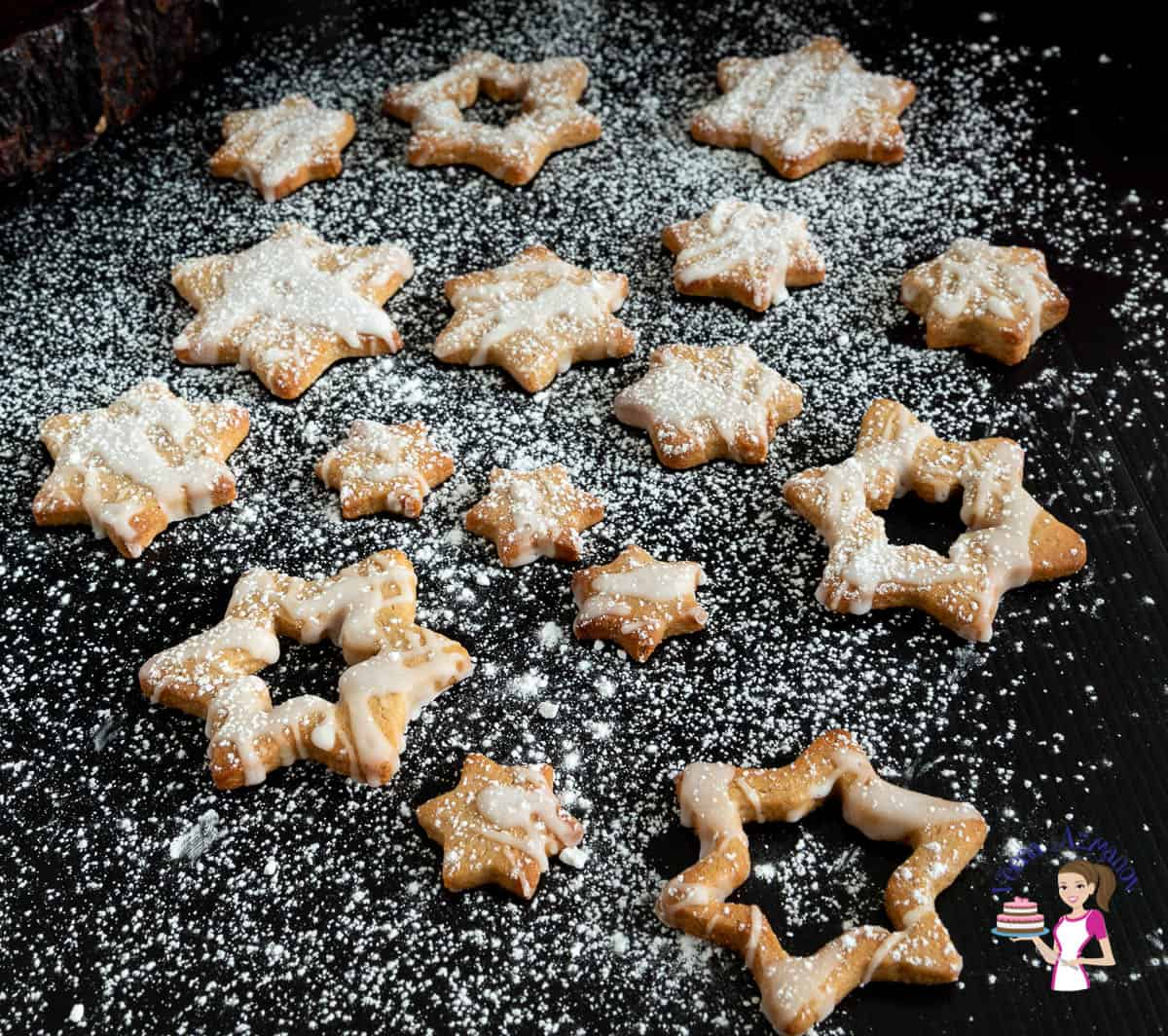Christmas star cookies on a black board