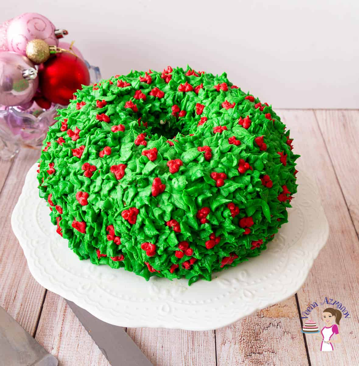 A frosted Christmas cake on a cake stand