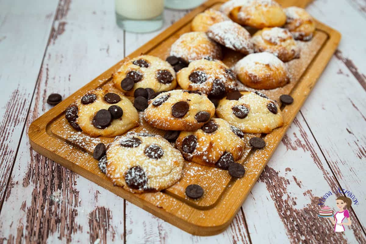 A wooden board with cookies