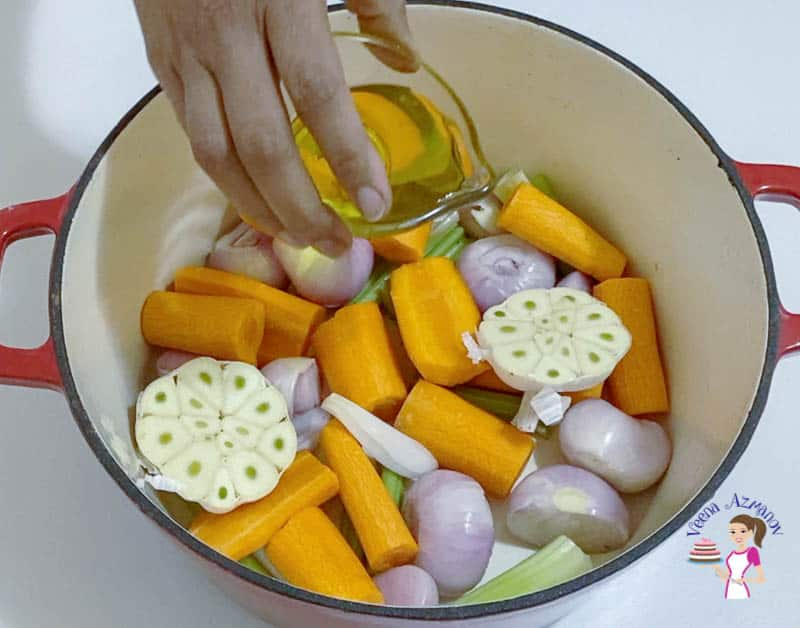 Pour oil over the veggies in the dutch oven