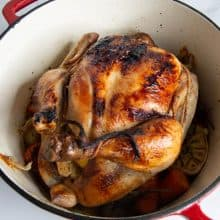 A roasted chicken in a dutch oven.