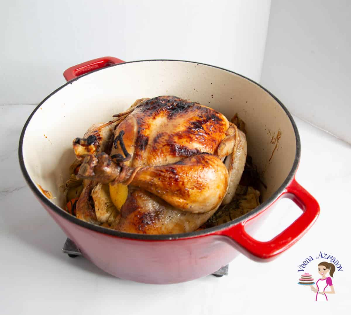 A full chicken roasted in a dutch oven