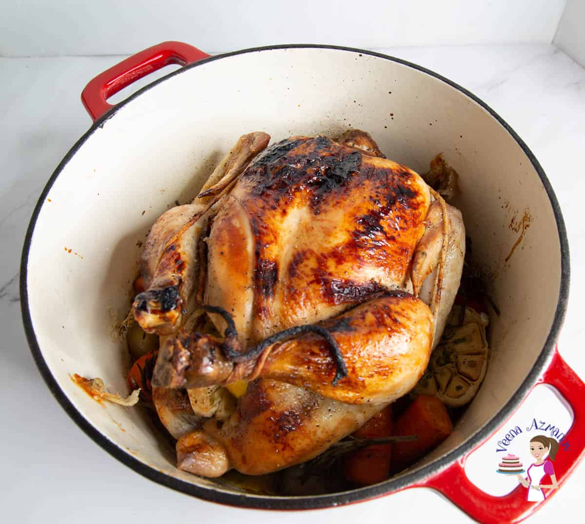 A roasted chicken in a dutch oven