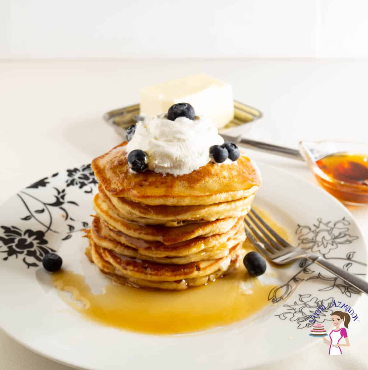 A stack of eggnog pancakes on a plate