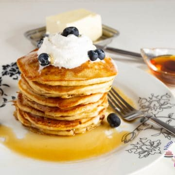 A stack of eggnog pancakes on a white plate