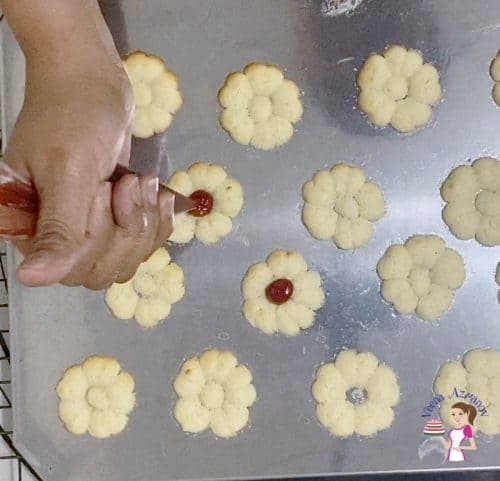 Fill the cookie centers with jam