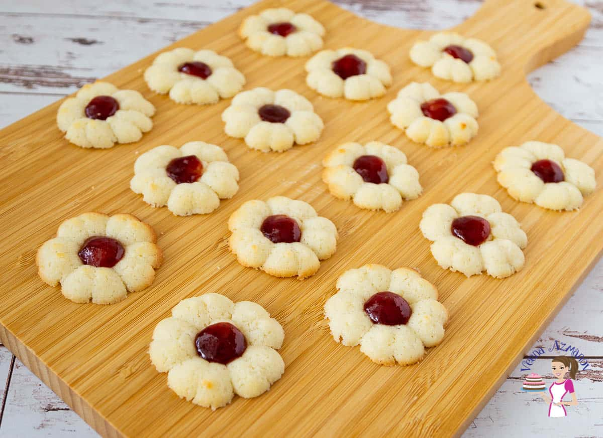 A wooden board with jam cookies