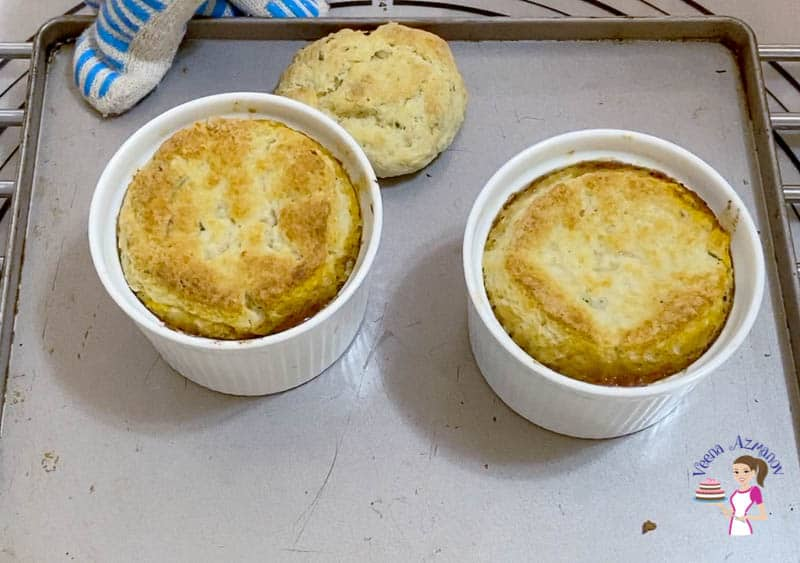 Two ramekins with baked lamb pot pies