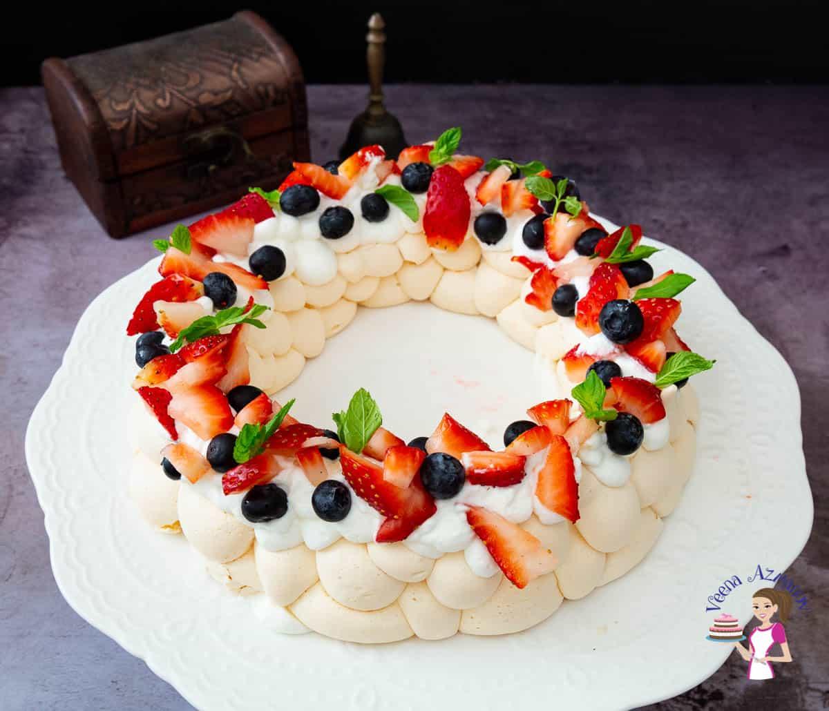 A meringue pavlova on a cake stand