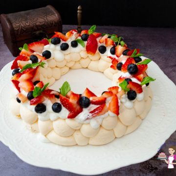 A pavlova wreath on a cake stand
