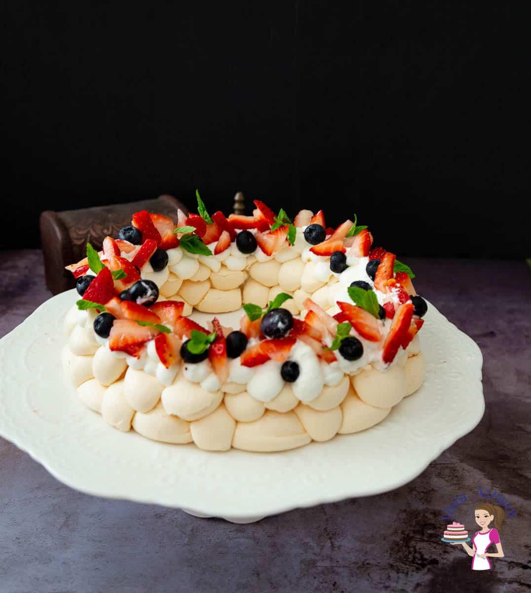 Assembled pavlova on a cake stand