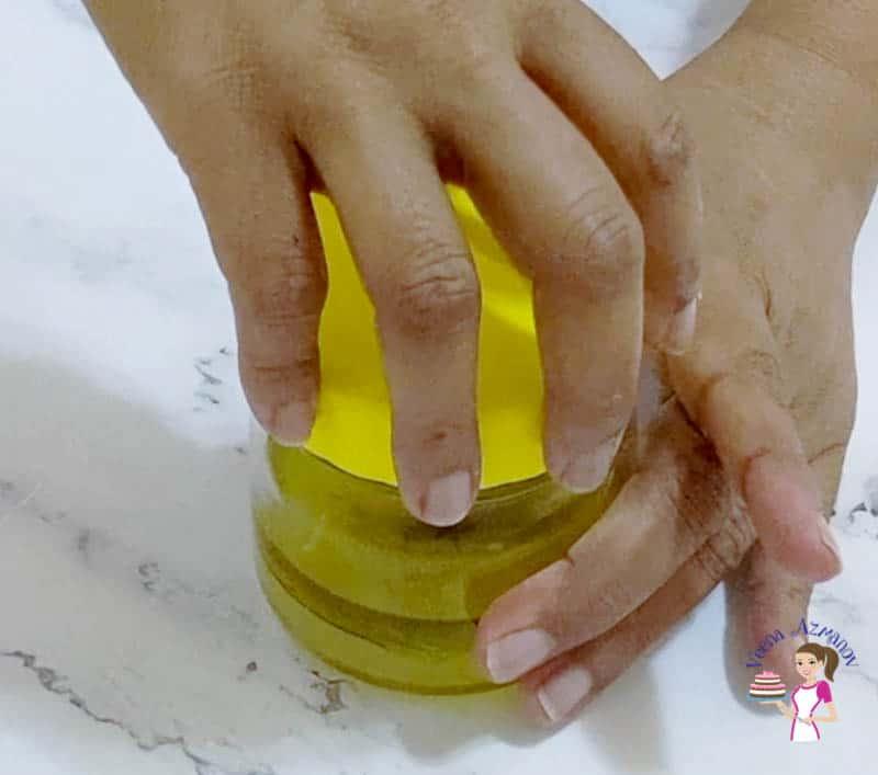 Close the salad dressing mason jar to shake it