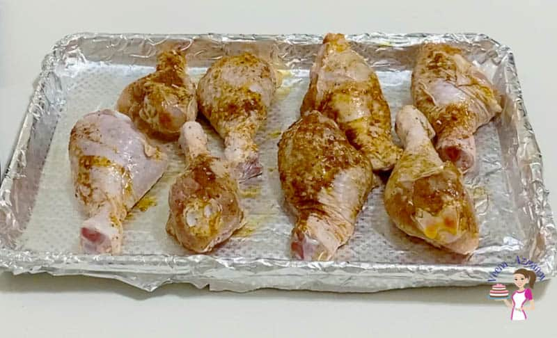 Spread the chicken on a baking tray lined with aluminum