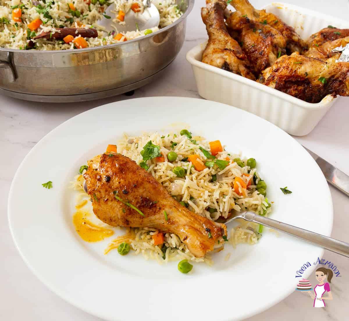 A chicken leg on rice pilaf