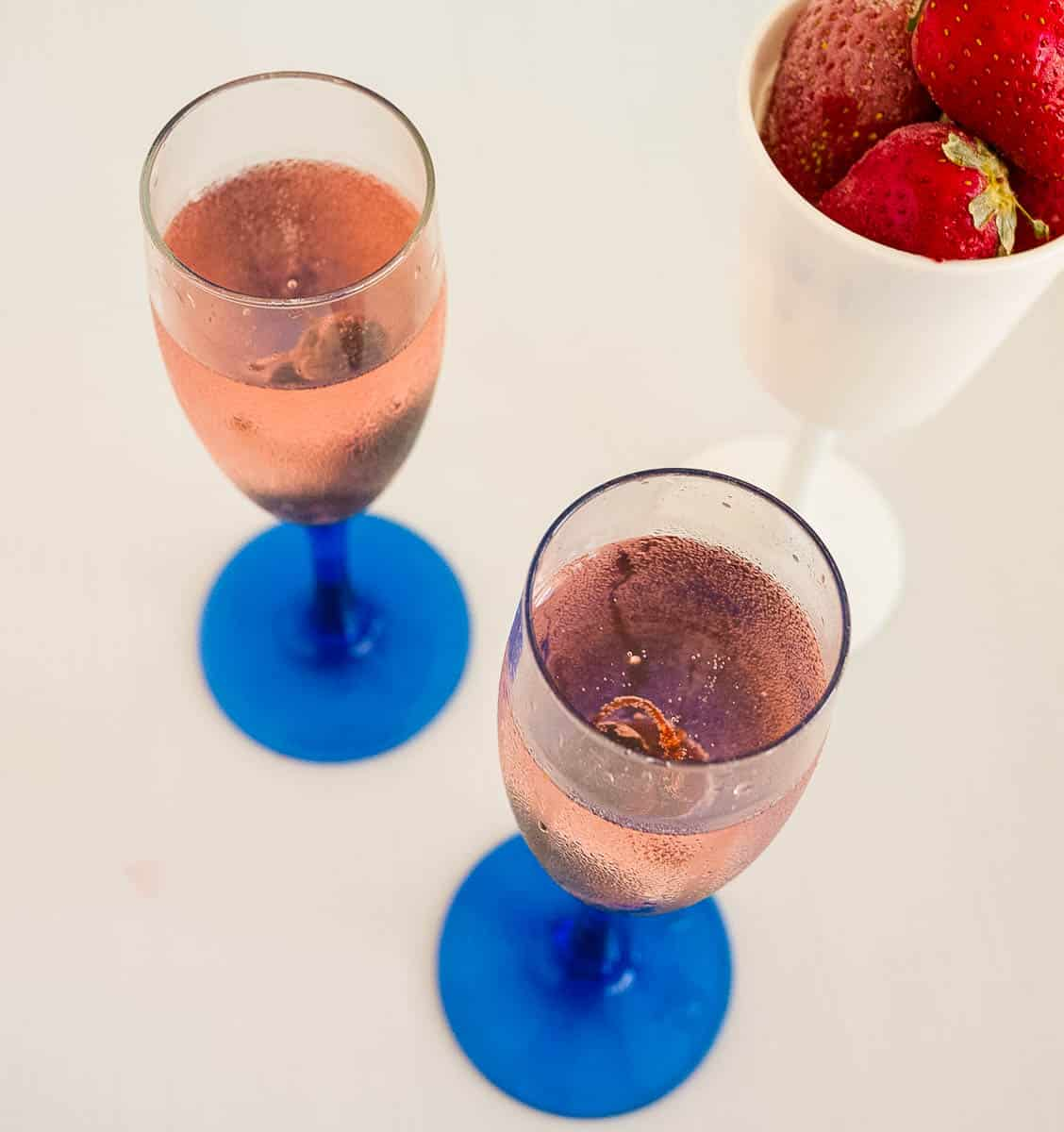 Two champagne glasses with cherry cocktail