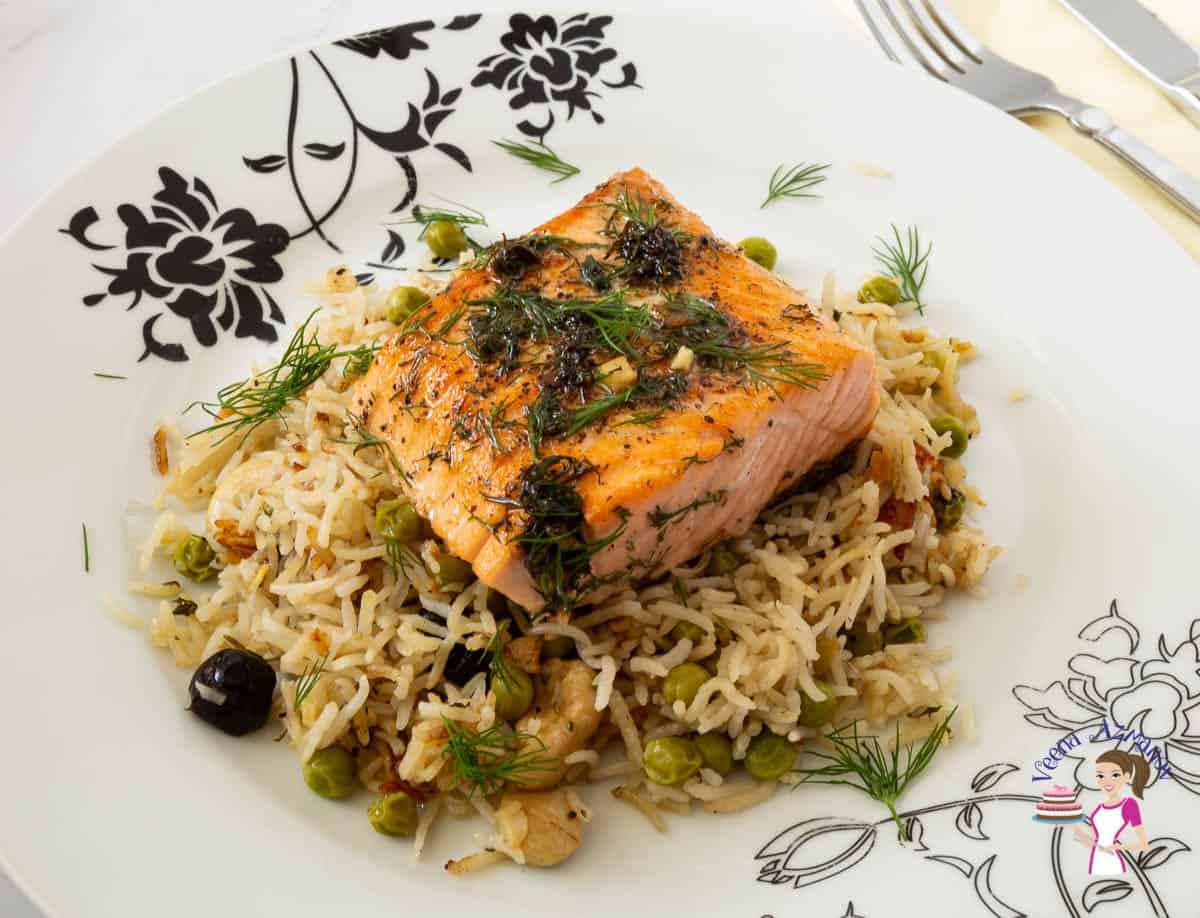A plate with rice pilaf and garlic butter salmon