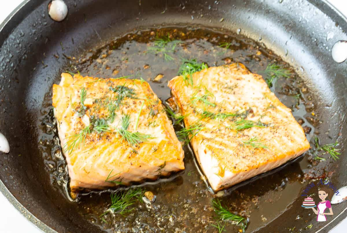 Skillet with pan fried salmon