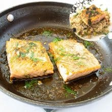Saute pan with salmon in garlic and butter.