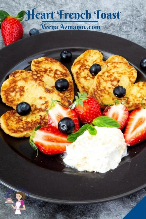 Heart shaped French toast on a plate.
