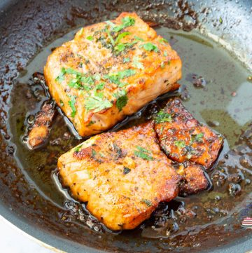 A skillet with salmon in honey garlic sauce