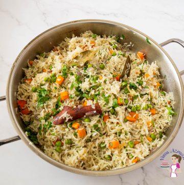 A saute pan with rice pilaf