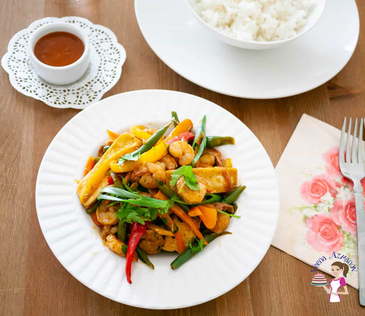 Stir fry with shrimps on a white plate