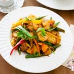 A white plate with stir fry
