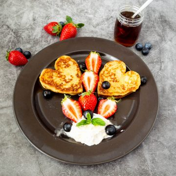 Black plate with heart shaped french toast