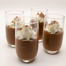 chocolate mousse glasses on a table