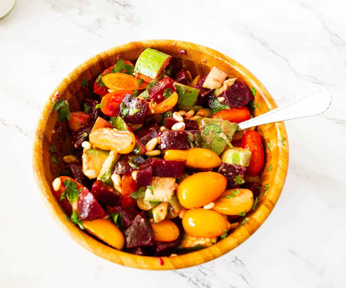 Beet salad in a wooden bowl