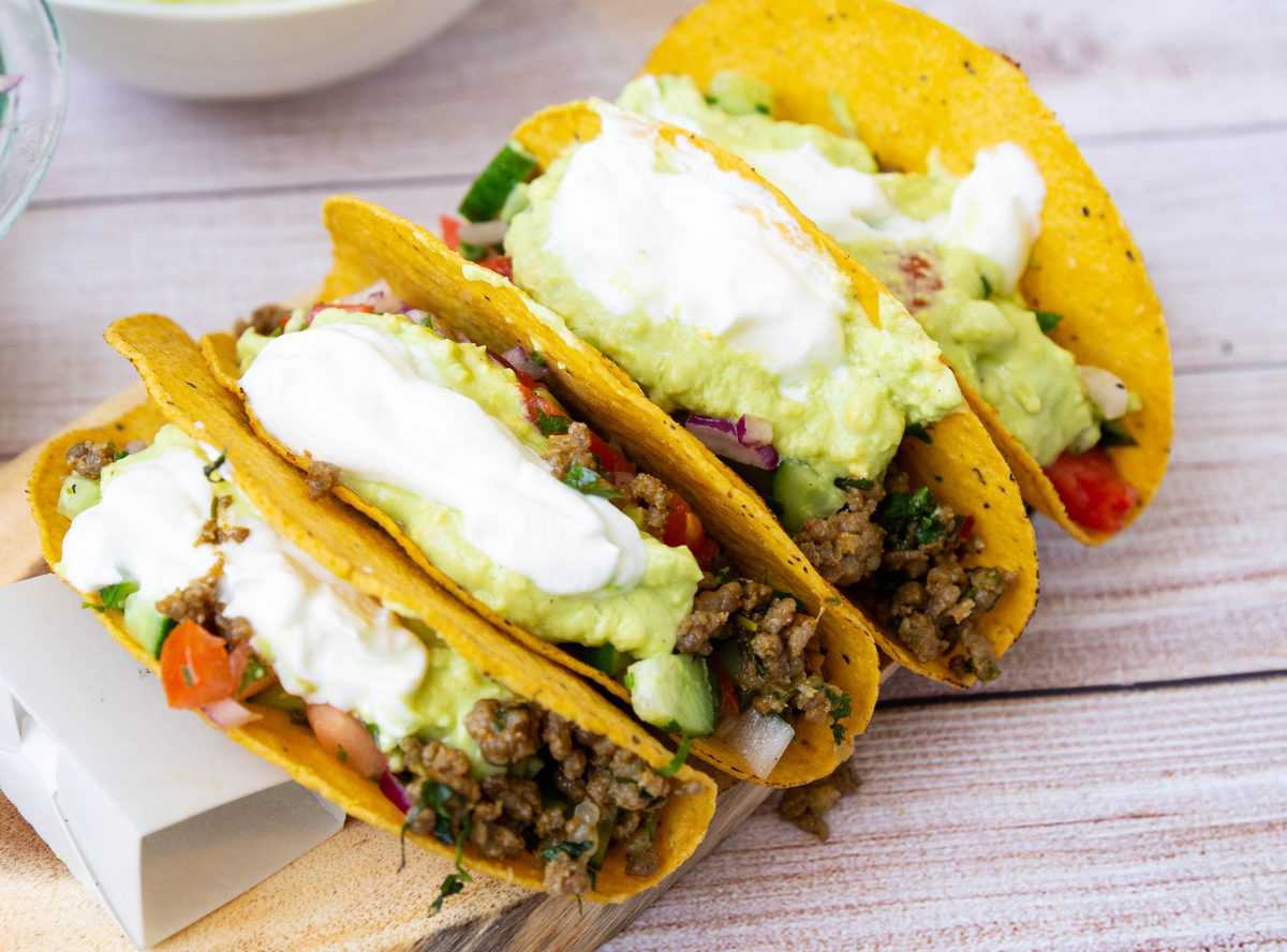 4 crispy tacos filled with beef and toppings.