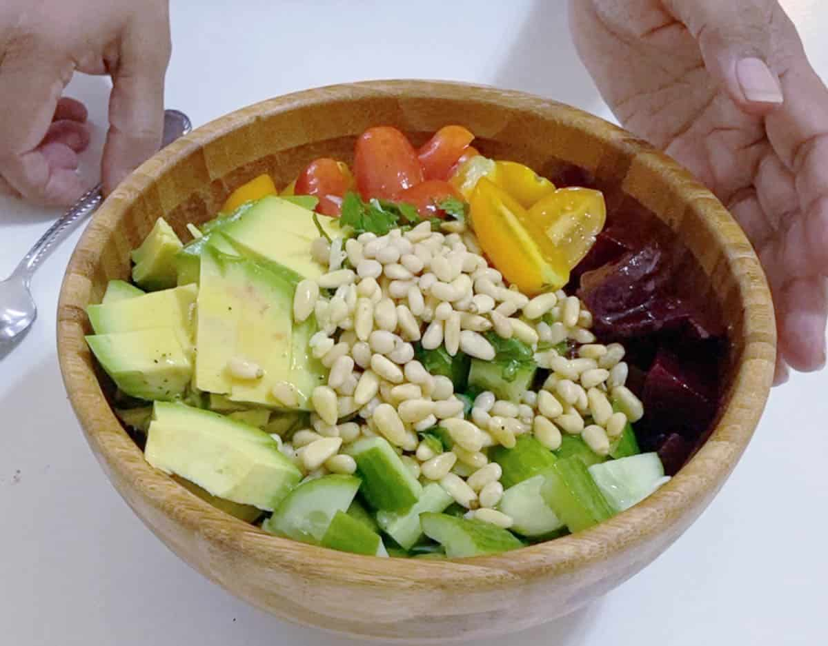 Preparing the salad in a wooden bowl