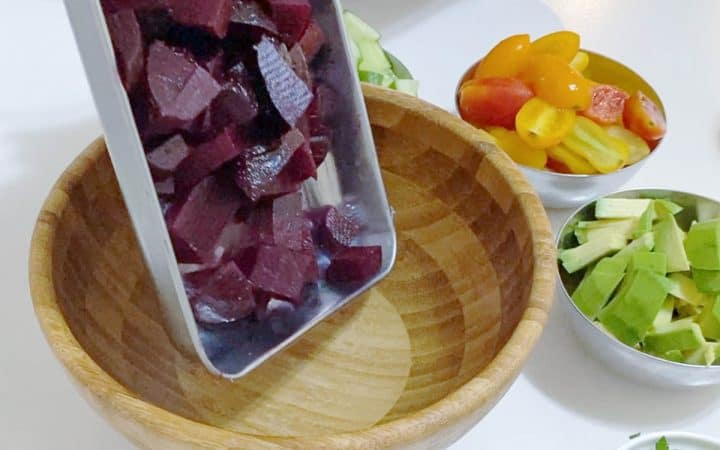 Adding chopped beets in a bowl