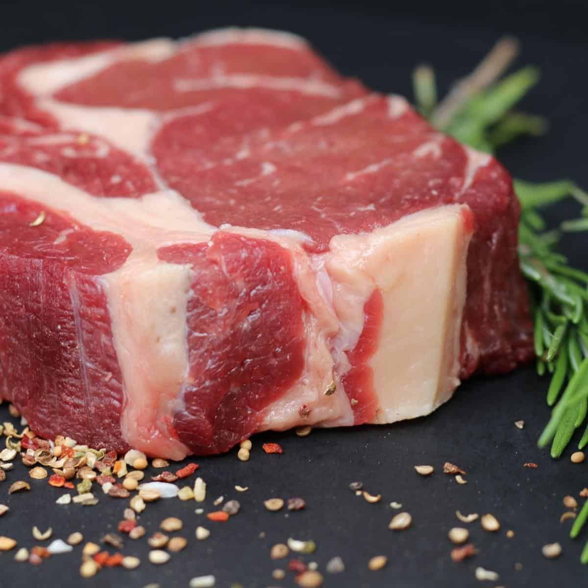 Steak seasoned on the table