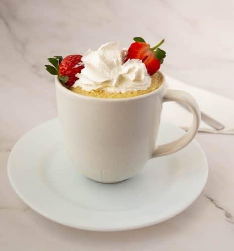 Mug cake with vanilla cake and whipped cream