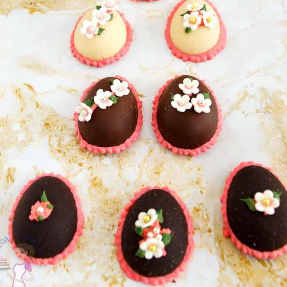 Chocolate marzipan eggs on a table.