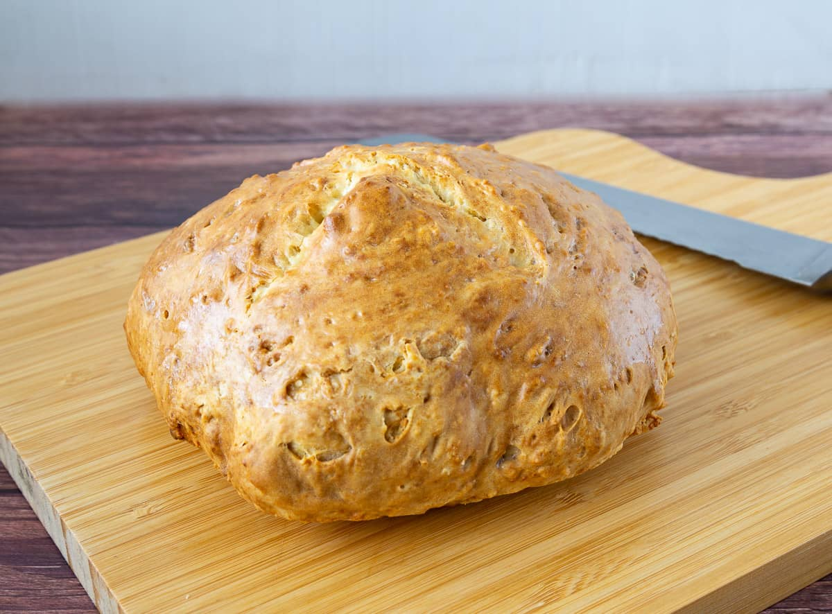 Loaf of bread on a wooden board.